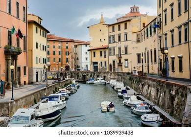 LEGHORN, ITALY - OCTOBER 3, 2017: Boats moored on canal in Venezia Nuova district of Livorno, Tuscany. Travel scenic cityscape postcard.