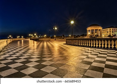Leghorn (Livorno), Tuscany, Italy: promenade Mascagni Terrace at night, an elegant square on the coast with black and white checkered floor, columned bannister and a round gazebo