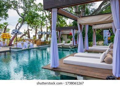 Legian, Bali / Indonesia - July 13, 2012: Luxury swimming pool on the beach