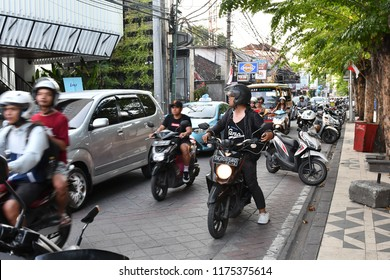 LEGIAN,BALI, INODNESIA, Sept 9, 2018: Busy street scene in Legian, Kuta.Bali, Indonesia. Legian is famous among tourist for nightclub and entertainment.