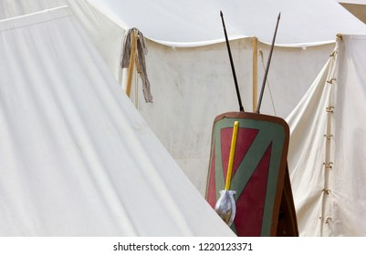 Legionary shield between tents in a Roman encampment