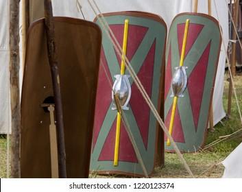 Legionary shields between tents in a Roman encampment