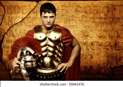 Legionary soldier in front of roman wall