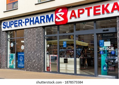Legionowo, Poland - July 9, 2020: Super-Pharm pharmacy, drug store in the city. View of the street and shops.