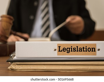 legislation document folder with judge or lawyer studying legal. Concepts of law, legislative, legislate.