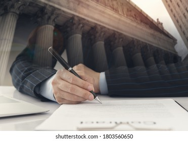 legislation law concept. lawyer signing legal document and agreement on desk in law office.