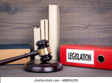 Legislation. Wooden gavel and books in background. Law and justice concept