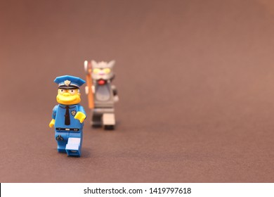 lego men from Simpsons lego chasing police with a axe