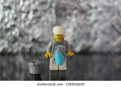 Lego mini figure toy man in uniform of painter with his tools posing for photo. Editorial image, studio shot, macro photography, close up.