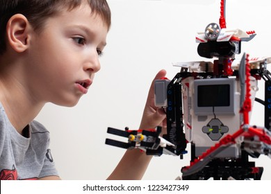 Lego Robot Mindstorms EV3. Child collects robot from the plastics details programmed on the computer, robotics. Modern training. The hottest gadgets. E-learning. Modern teaching technology. Education