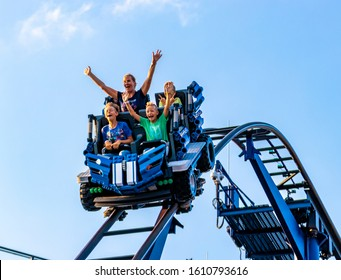 LEGOLAND, GERMANY - AUGUST 24th, 2019: family having fun riding a rollercoaster in amusement park