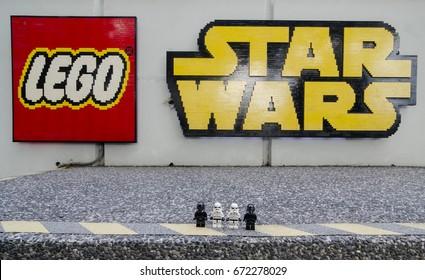 legoland malaysia resort. july 1, 2017. lego starwars trooper standing in front of lego and starwars lego in legoland malaysia.