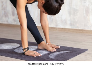 The legs and arms of a young woman - Pilates instructor during a class in the gym. Health and beauty concept