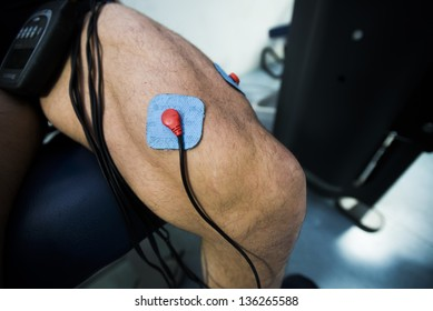 Legs of a athlete with electrostimulators