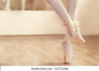 Legs of ballerina in ballet shoes, closeup