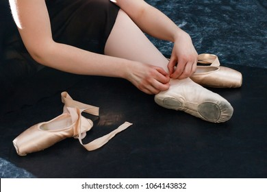 legs of ballerina, Pointe shoes. ballet dancers  on the dark black background close up shoot