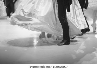 Legs of ballerinas and dancers during the performance of the classical waltz on the stage of the theater