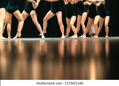Legs of ballet dancers on stage in theater