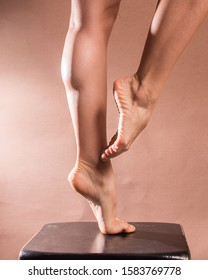 Legs and bare feet of pointy ballerina