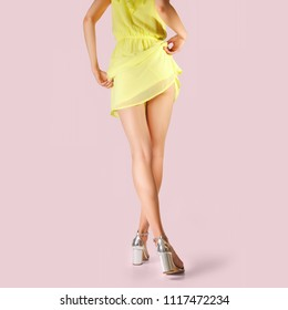 Legs of beautiful girl with short lifted dress. Photo with clipping path.