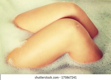 Legs of beautiful young caucasian female in bath