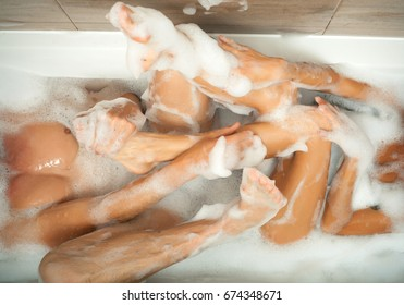 Legs of beautiful young caucasian female in bath. Young sexy couple enjoy each other in bathroom. Passionate couple kissing, boy and girl. Having sex. Young lovers. People in love. Positions kamasutra