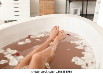 Legs of beautiful young woman relaxing in bathtub