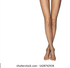 legs with black fishnet tights. Isolated over white background.