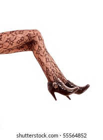 Legs with black high heels isolated against a white background