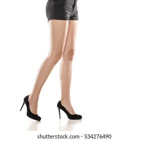 legs, black shorts and high heels on white background