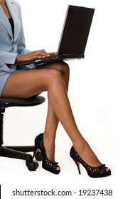310d1280d737 Legs of business woman sitting on a chair holding a laptop computer on her  lap