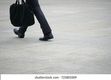 The legs of businessman walking on the pavement, Taking step movement, Business concept