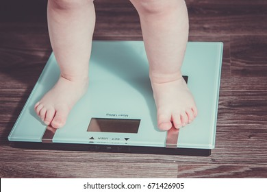 The legs of the child on the scales