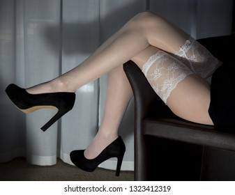 Legs covered from a pair of white stockings