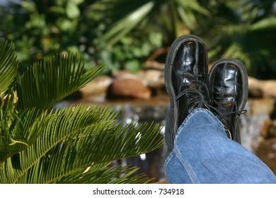 Legs crossed in the tropics