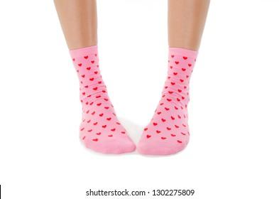 Legs with cute pink socks on white background. Minimalism fashionable  set