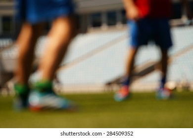 Legs of football players in the blurring