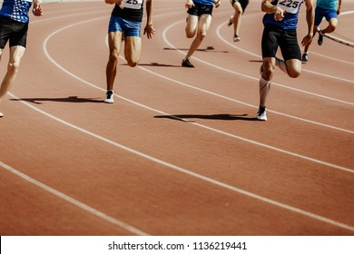 legs group runners sprinter men race 200 meters in stadium