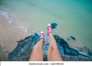 Legs hanging from the cliff - Adventure time.