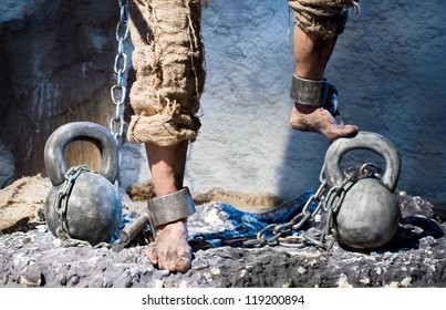 Legs in heavy iron shackles