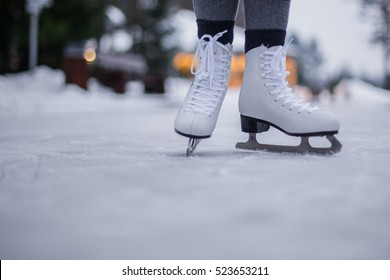 Legs of ice skater with start sign on the ice rink, view from above