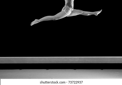 legs jump on balance beam