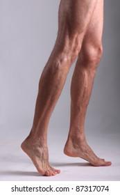 Legs of a male.