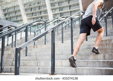 Legs of man going up on stairs