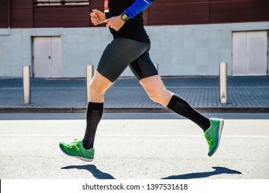 ffe25cf34 legs man runner athlete in compression socks running marathon