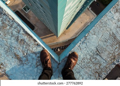 Legs of a man standing on the edge, Moscow