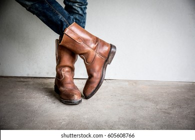 Legs of man wearing boots standing