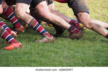 legs of men in a scrum or maul in rugby union