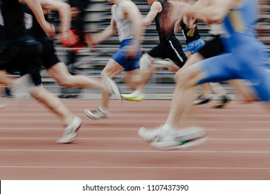 legs men sprinters runners running athletic track