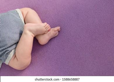 Legs of a newborn boy